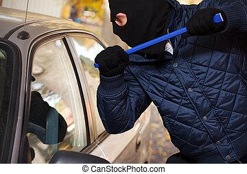 Hooligan trying to break a car's window