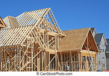 house under construction during framing stage