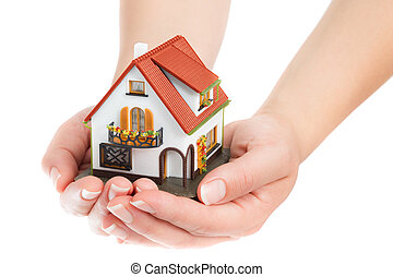 house in hands - real estate