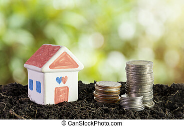 house in soil, saving money to build a house concept