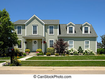 Two story vinyl siding house in the suburbs.