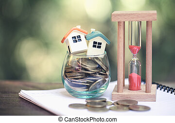 House model and coin, Concept of property management, home, Invesment and Risk Management.