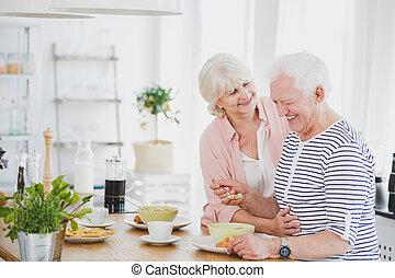 Hugging couple in the kitchen