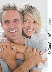 Hugging couple smiling at camera