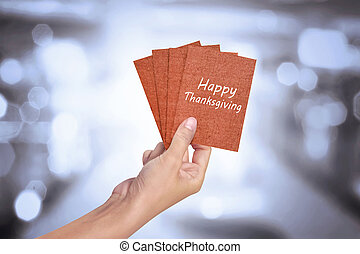 Human hand holding Happy Thanksgiving card