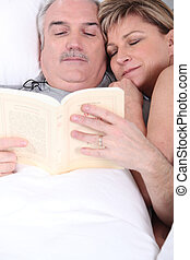 Husband and wife cuddling