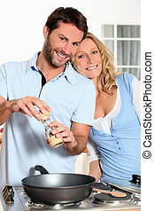 Husband cooking for wife