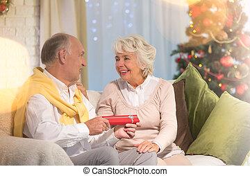 Husband giving christmas present