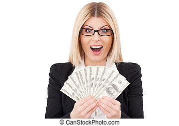 I am rich! Happy mature businesswoman holding money in her hands and smiling while standing isolated on white