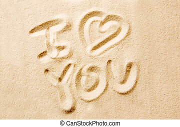 I love you message written in golden sand