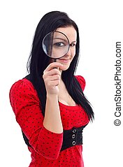 Girl holding magnifying glass in front of her eyes