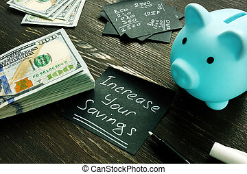 Increase your savings sign, piggy bank and money.
