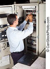 industrial engineer repairing machine