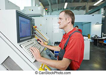 industrial worker at tool workshop