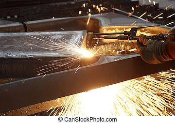 Industrial worker welding in steel factory
