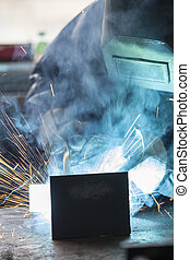 Industrial worker welding