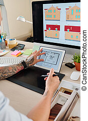 Interior designer with graphic tablet