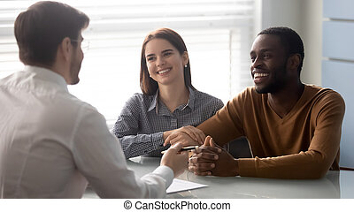 Interracial couple at meeting with financial advisor in office