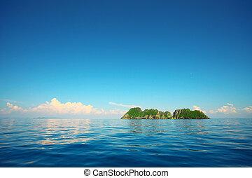 Tropical island in a blue sea and blue sky