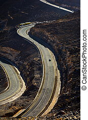 Jabal Jais mountain road at sunset. The highest mountain in the