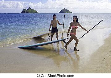 Japanese couple on paddle boards