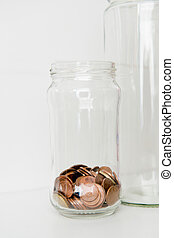 Jar of Coins - Downsizing and low funds concept