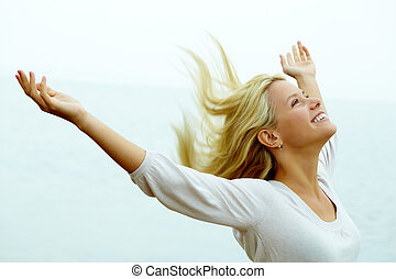 Portrait of happy young girl with stretched arms enjoying life