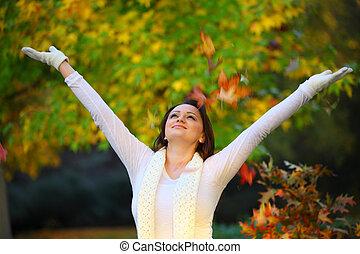 joyful woman in autumn
