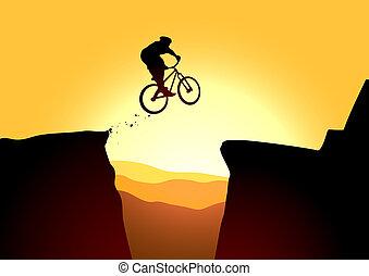 Jump in mountain on the bike
