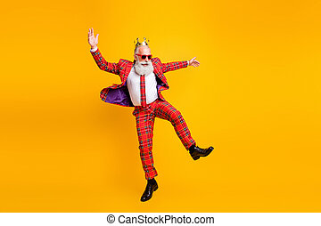 Just dance. Full body photo of funny grandpa white beard dancing youngster moves little drunk wear crown sun specs gingham red costume isolated yellow color background