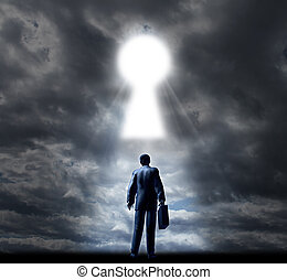 Key to business success with a businessman standing with a briefcase looking into a glowing key hole opening in the cloudy sky as a concept of future opportunity and aspirations.