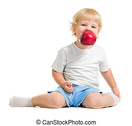 kid keeping apple in mouth