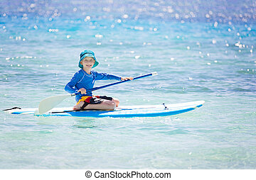 kid stand up paddleboarding