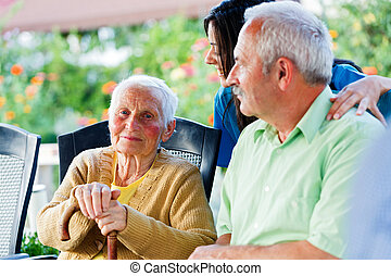 Kind Elderly Lady with Visitors