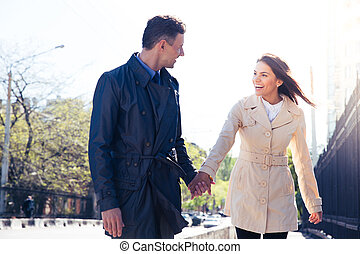 Laughing couple walking outdoors