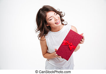 Laughing woman holding gift box