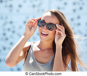 Laughing young woman with sunglasses