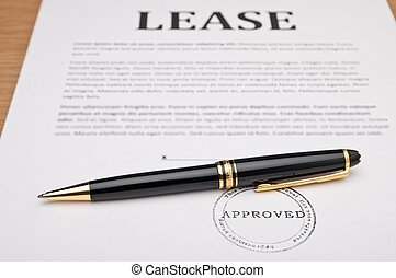 Lease contract and pen. The image suggests someone is ready to sign this Lease contract