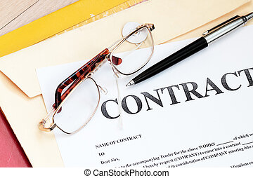 legal contract law papers with pen and glasses
