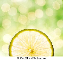 Lemon slice over abstract blurred background