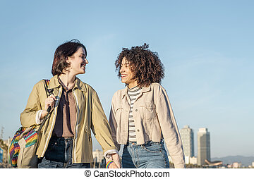 lesbian couple walking and laughing in Barcelona