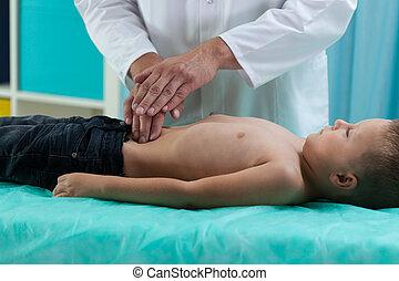Little boy during stomach examination