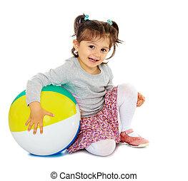 Little girl hugging a big ball