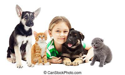 little girl hugging puppy and kitten