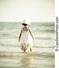 little girl on beach vacation (Vintage stye)
