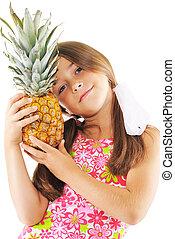 Little girl with big pineapple