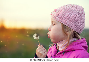 little girl with dandelion