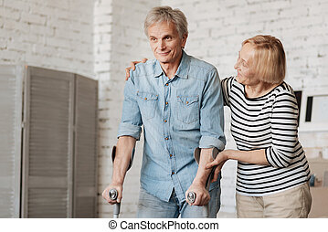 Lively charming senior couple going through recovery together