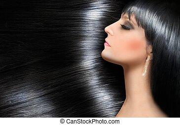 Log shiny hair of a beautiful brunette