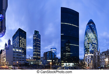 Evening time shot of London`s financial district, Including Tower 42, Aviva and Gherkin.